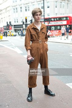 Fashion photography student Alessandro Merlo wears vintage pilot suit and vest, with Dr.Martens shoes on day 4 of London Collections: Men on June 15, 2015 in London, England.