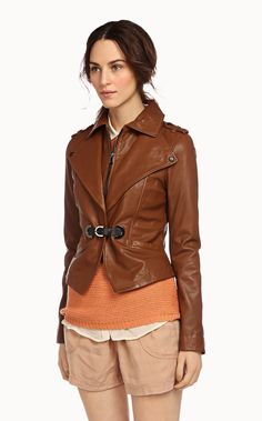 Kristy is a washed leather jacket for women with removable collar and buckle closure.  Zipped removable collar Buckle front closure Decorative shoulder tabs with snaps 2 inset pockets at waist Outershell: Genuine leather Lining: 100% Polyester Dry clean by leather specialist only Model is 5'10 and is wearing a size Xsmall