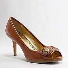 "COACH Dorita pump in Whiskey |   Gorgeous in leather with a strong, stacked heel and the curvy lines of a peep-toe pump. | •Smooth leather. •Soft leather lining. •2 1/2"" heel. 