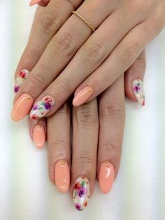 Peach   floral stiletto nails. Hmm, I actually really like this, considering I don't really like any of the individual elements by themselves. It works together in a lovely fashion though.