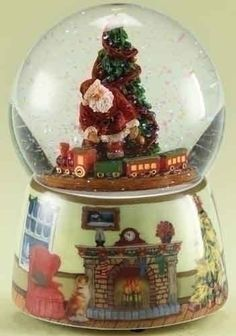"""$74.99-$89.99 From the Glitterdomes Collection Item #35612  Each glitterdome features Santa Claus, a decorated Christmas tree and revolving train set, sitting upon a base with a festive fireplace decal Glitterdomes wind up to play the classic Christmas song """"We Wish You A Merry Christmas""""  Dimensions: 5.5""""H x 4""""W x 4""""D Globe dimensions: 100mm Material(s): resin/glass/glitter  Pack includes 2 of  ..."""