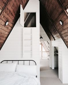 lovely bedroom in the attic. lovely wooden roof and white painted walls