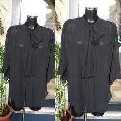 Camicia cocktail nera donna con fiocco Exsy  Manica 3/4. Colore nero. Tessuto in chiffon. Taglia xl/48.  https://www.lorcastyle.it