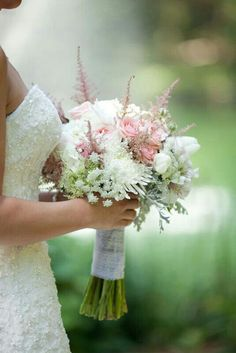 {Lovely, Bridal Bouquet Comprised Of: White Spider Mums, White Tulips, White Roses, White Queen Anne's Lace, Green Queen Anne's Lace, Pink Astilbe, Pink Roses, Lace Leaf Dusty Miller···················································}