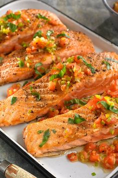 NYT Cooking: Here is a fresh and simple way to prepare salmon that is ready in about 20 minutes. Most of that time will be spent preparing the vegetables. You do have to blanch, core and chop the tomatoes, but that is quick work (and we won't tell if you use the canned, diced sort. Just drain first.). Once that's done, sauté the fish and set aside. Throw tomatoes, leeks, lemon juice and freshly ground peppe...