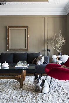 Georg Kayser opted for a masculine color palette that includes muted gray walls and dark furnishings.  Click through for the full story!