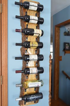 Beautiful live edge wine rack, wonderful wood grain. 8 bottle wine rack with individually crafted steel wine cradles. Wood has been clear
