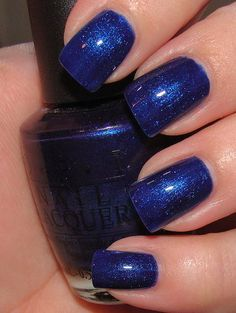 OPI Yoga-ta Get This Blue.  This is a pretty blue but needs three coats to be opaque.  It needs a base coat due to staining.