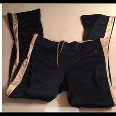 Nike pants Navy blue nike pants with a pewter color stripe. Nike Pants Track Pants & Joggers