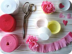 make paper flowers by fringing streamers then stuff them in paper muffin cups!