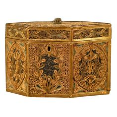 "Hexagonal Rolled Paper Tea Caddy c. 1780  England  late 18th Century  A Rolled-paper and gilt-wood Tea Caddy, in hexagonal form with beautiful designs on all sides formed in minute rolled strips of paper. The hinged top mounted with a metal handle, enclosing a foil-lined interior with a new inlaid wooden lid.    Reference: Figure 15, ""Rolled, Scrolled, Crimped & Folded: The Lost Art of Filagree Paperwork"" by Florian Papp for a Caddy in Filagree with hexagonal form and identical handle…"