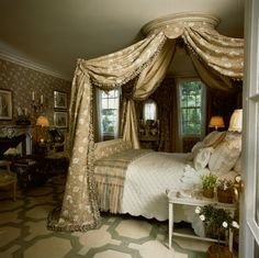 Howard Slatkin - In a guest bedroom in the New Jersey countryside,  Slatkin designed the linen print of Cecile Brunner roses for the room, and it is used luxuriously on walls, curtains and the lit a la Polonaise. Printed voile bed linens were also designed for the room. Floor is painted, and the 18th century French mantle is faience.