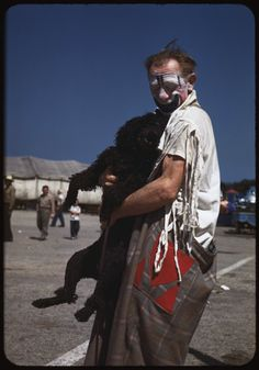 Charles W Cushman. Clown and black poodle. 1947