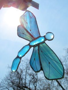 Iridescent Blue Dragonfly Stained Glass Suncatcher. $25.00, via Etsy.