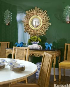 """""""This year, I'm seeing soft and sophisticated neutrals everywhere, but not as much on the walls anymore. I'm loving the idea of layering neutral-color furnishings and accessories in rooms with walls painted in intense, saturated colors, like army green."""" — Jenny Komenda As seen here in a dining room in San Francisco designed by Palmer Weiss.   - HouseBeautiful.com"""