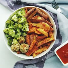 Oil and salt free baked sweet potato and white potato wedges with steamed broccoli