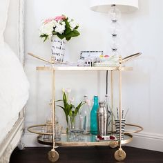 """A lot of you have been asking where our bar cart is from... It's by @onekingslane + you can get a link to it straight to your inbox by 'liking' this photo…"""