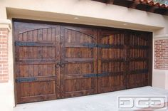 Breaking a large surface such as a double car garage door is simple. Designing a garage door that simulates smaller door panels as done on this Spanish Colonial custom garage door. Custom Garage Doors, Modern Garage Doors, Wood Garage Doors, Barn Doors, Garage Door Handles, Carriage Garage Doors, Wooden Doors, Spanish Style Homes, Spanish House