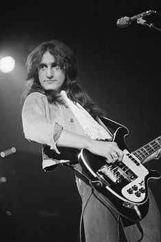 Bassist and singer Geddy Lee performing with Canadian progressive rock group Rush at the Civic Center in Springfield Massachusetts during the band's. Rush Concert, A Farewell To Kings, Rush Band, Jazz, Geddy Lee, Neil Peart, Rock Groups, Progressive Rock, Celebrity Travel