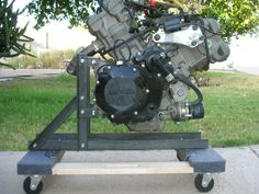 Mobile Engine Stand by Six5 -- Homemade mobile engine stand constructed from angle iron and a commercial moving dolly. http://www.homemadetools.net/homemade-mobile-engine-stand