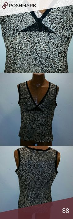NEW YORK AND COMPANY ANIMAL PRINT TANK SZ XL Animal print tank with black lace. Dress up with black blazer or casual with black capris. Either way you win. New York & Company Tops