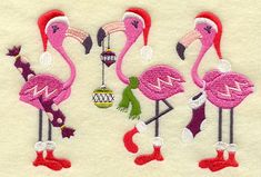 These Christmas Flamingos need to be adapted to an appliqué wall hanging!