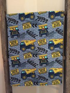 A personal favorite from my Etsy shop https://www.etsy.com/listing/264183385/tonka-truck-baby-blanket-grey-minky