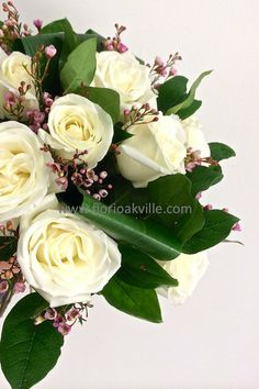 White Roses- Ultimate Love Collection| FIORI Oakville A beautiful dozen rose complemented with pink wax flower and premium greens.