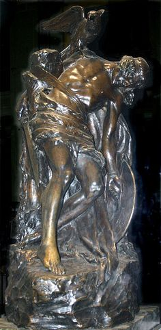 """Statue of """"The Dying Cuchulain"""" by Oliver Sheppard (1911), now at the GPO, Dublin. Although, apparently, his (Cuchulainn) tutelary goddess, the Morrigu seems to have been made the instrument through the decree of a cruel fate, in his premature death."""