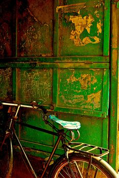 bicycle by a green door