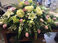 Pink white and green casket spray
