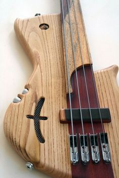 Prometeus Guitars fretless bass... like the embedded controls in the side