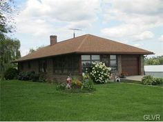 """Did you ever dream of living on a farm but did not want the work associated with it? This brick ranch with three bedrooms and 1.5 baths sits """"down on the farm"""". No matter which window you look out of you will see pastoral views. The living room offers a wall of windows for tranquility. SOLD"""
