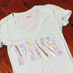 Pink t shirt Light blue v neck PINK t shirt.  Sleeves are rolled and sewn cuffed. Victoria's Secret Tops Tees - Short Sleeve