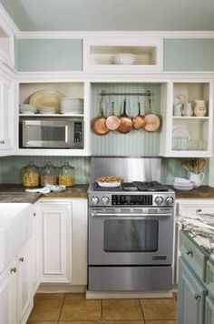 hum... beadboard in the kitchen (nice beachy feel).  also like the transposition of the backsplash color onto the island cabinets. very cute!