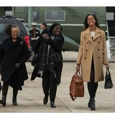 Malia arriving with her Aunt Auma Obama (Obama's sister) and her godmother Kaye Wilson at Air Force One for the flight to Obama's Farewell Address in Chicago