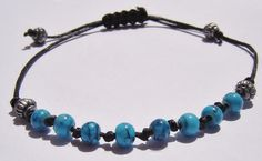 Knotted Bracelet with marbled turquoise beads on black by dzinebug. €8,00, via Etsy.