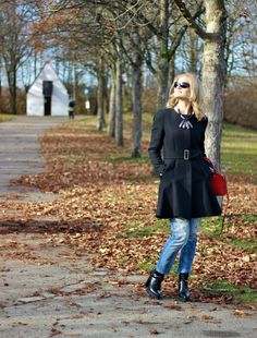 BLACK COAT, BLACK BOOTS, RED BAG