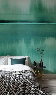 Go green. This watercolour wallpaper mural is oozing with deep emerald green hues and depicts a peaceful still lake. It's perfect for creating a calming atmosphere in bedroom spaces.