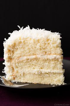 Coconut Cake - this is one of the best cakes I've ever made! So soft and tender and perfectly moist. Love the coconut cream cheese frosting too. Going to have to make this for my sister Coni.... she loves coconut cake... mmmmm