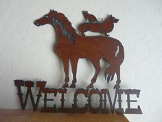 Rustic Recycled Metal Horse, Welsh Corgi, Cat Welcome Sign. $20, via Etsy.