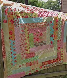 My Quilt Infatuation:Ring Around the Rosey: easy and fun quilt, definitely can make with the leftover strips from a fabric line or quilt that you just love