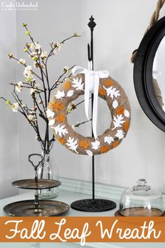 Welcome fall with this simple fall DIY felt leaf wreath. It takes no time at all, and makes use of some fabulous leaf die-cut shapes!