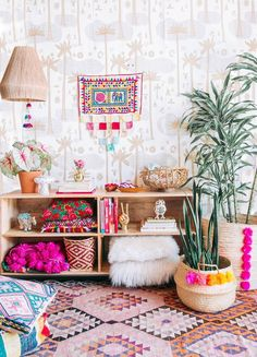 We love this bohemian space! So full of life and colour. The tall plants really do add a nice touch in the final decor.