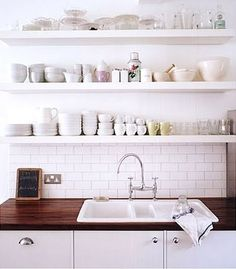 simple white kitchen with great shelving use