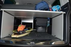 Multivan full load through capability for surfboards - pictured here with single bed to allow individual seat to remain in place.