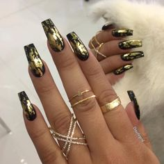 Nails are little over the top for me but that nail polish is sleek