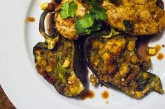 Roasted poblanos are stuffed with feta and sweet corn for a delicious snack or meal.