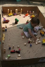 cardboard city ... large cardboard box, felt tip pen for the roads, blocks and small toys and one toddler ... ready to go!