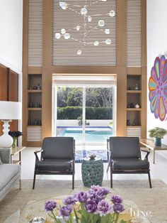 Vibrant hues and vintage furnishings create an eclectic house in Key Biscayne that radiates high-octane energy inside and out.